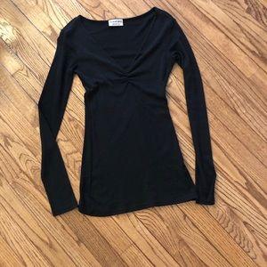 Black long sleeves neck top.